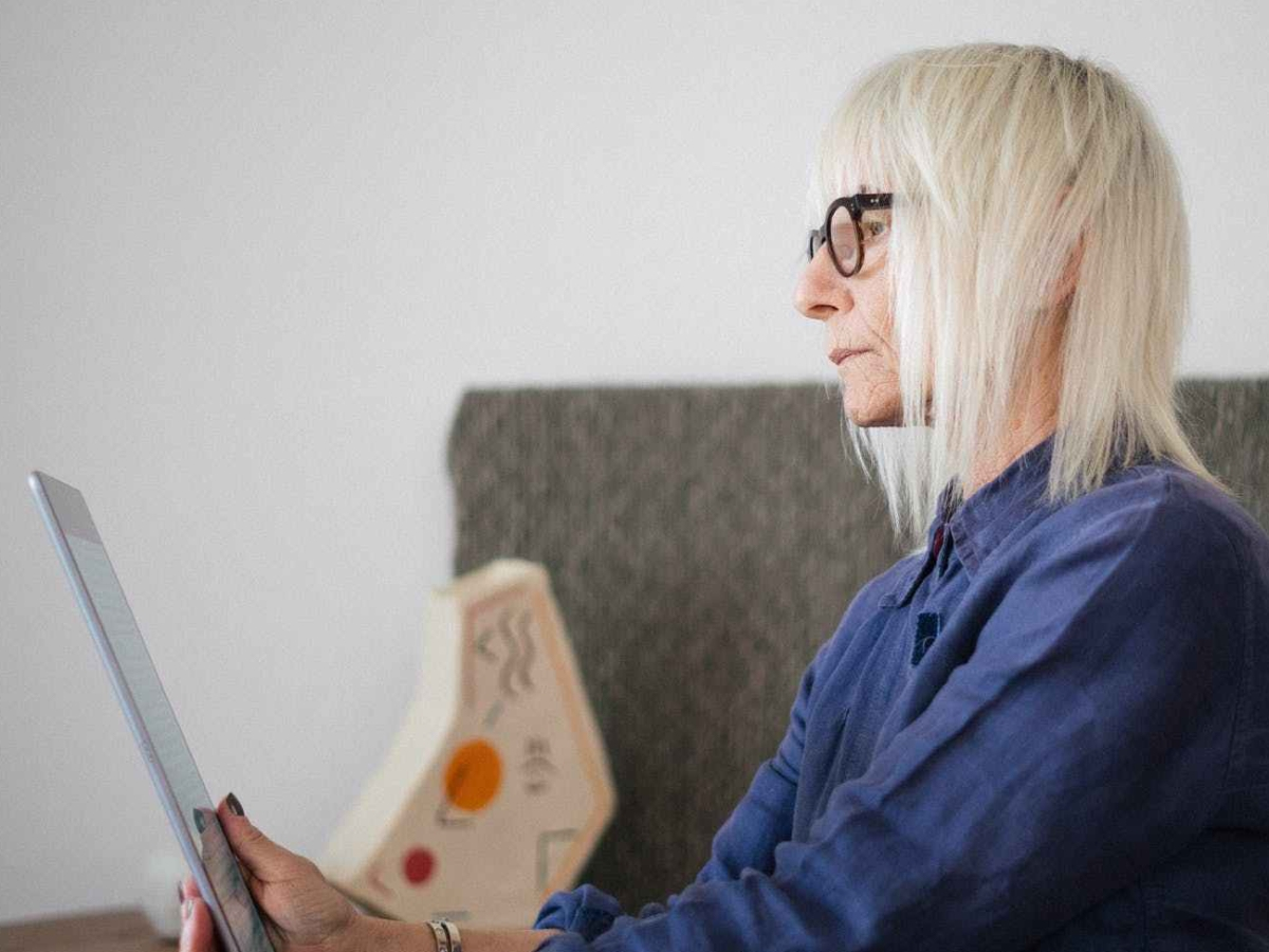 older women reading on a tablet
