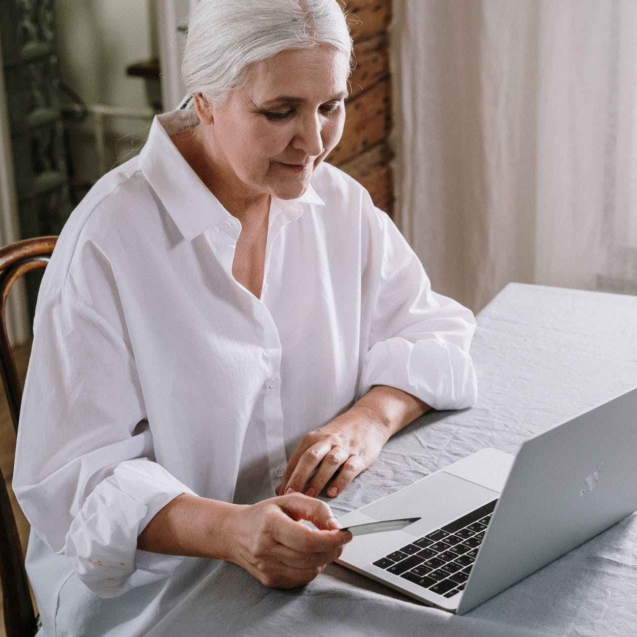an old woman using a laptop